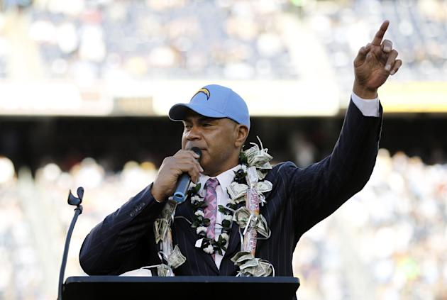 Former San Diego Chargers great Junior Seau is inducted into the Chargers Hall of Fame during a halftime ceremony in an NFL football game against the Denver Broncos, Sunday, Nov. 27, 2011, in San Dieg