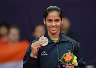 India's Saina Nehwal poses with her bronze medal after beating China's Wang Xin in their bronze medal women's singles badminton match at the London 2012 Olympic Games in London