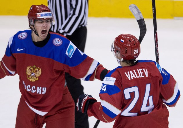Russia defenceman Ziyat Paigin, left, reacts with teammate Rinat Valiev (24) after scoring past Sweden during second-period semifinal hockey action at the world junior championships in Toronto, Sunday, Jan. 4, 2015. (AP Photo/The Canadian Press, Nathan Denette)