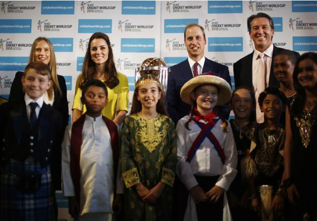 Britain's Prince William and his wife Catherine pose with children with Australian women's cricket team member Perry and former Australian cricket team member McGrath at the Sydney Opera House
