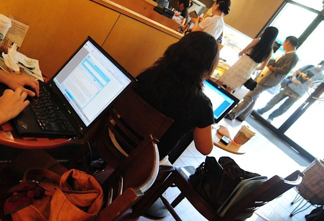 Customers use their laptop computers in a cafe in Beijing. A Chinese police chief accused online of keeping twin sisters as mistresses has been sacked, state media said Monday, the latest official to fall in a sex and corruption scandal in China in recent weeks