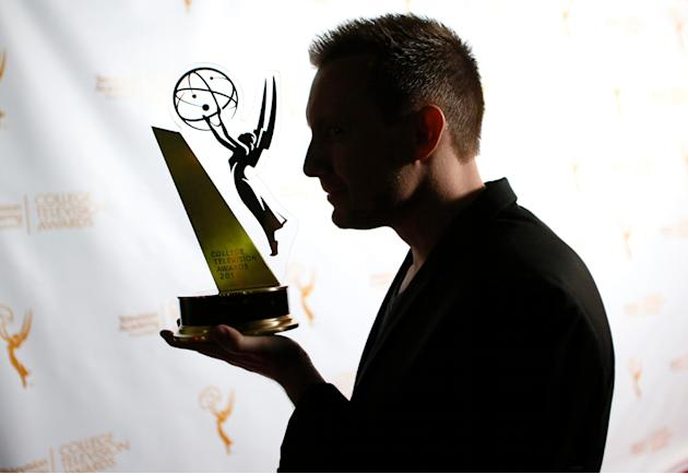 "IMAGE DISTRIBUTED FOR THE TELEVISION ACADEMY - Daniel Clark of Brigham Young University poses with the award in the Animation category for ""Owned"" the 35th College Television Awards, present"
