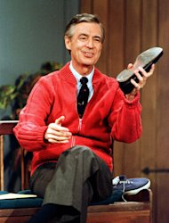 "FILE - This June 28, 1989 file photo shows Fred Rogers as he rehearses the opening of his PBS show ""Mister Rogers' Neighborhood"" during a taping in Pittsburgh. Rogers, the late host of ""Mister Rogers Neighborhood,"" is featured in a PBS Digital Studios video mashup that celebrates the power of imagination. The piece turns clips from Rogers show into a sweetly inspiring music video, ""Garden of Your Mind."" A PBS spokesman says the video posted Friday on PBS Digital Studios' YouTube channel is intended to get people talking about public television. More such tribute mashups are planned, spokesman Kevin Dando said. (AP Photo/Gene J. Puskar, File)"