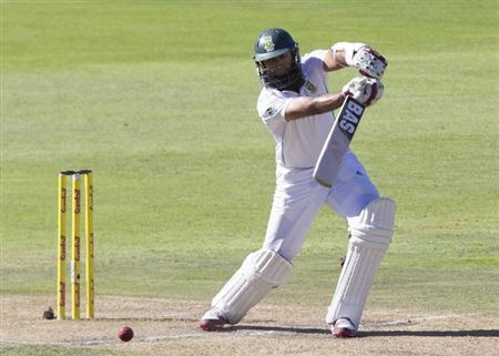 South Africa's Hashim Amla plays a shot during the third day of the second cricket test match against Australia in Port Elizabeth February 22, 2014. REUTERS/Rogan Ward