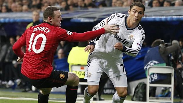 Real Madrid's Cristiano Ronaldo vies with Manchester United's striker Wayne Rooney (Reuters)