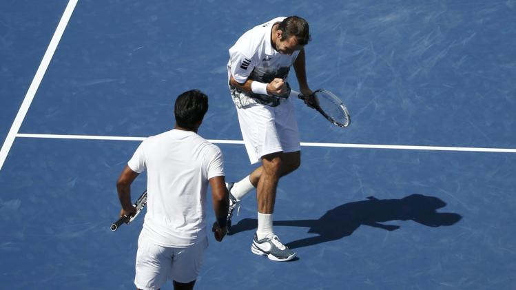 Paes of India and Stepanek of the Czech Republic celebrate point against Bob and Mike Bryan of the U.S. in their men's doubles match at the U.S. Open tennis championships in New York