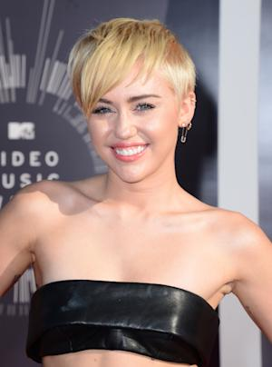 Miley Cyrus arrives at the MTV Video Music Awards at …