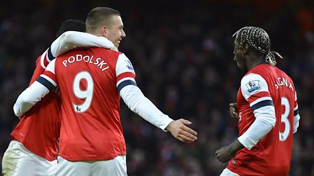 Arsenal's Lukas Podolski (L) celebrates scoring with team-mate Bacary Sagna (R) during their English Premier League soccer match against Stoke City at Emirates Stadium