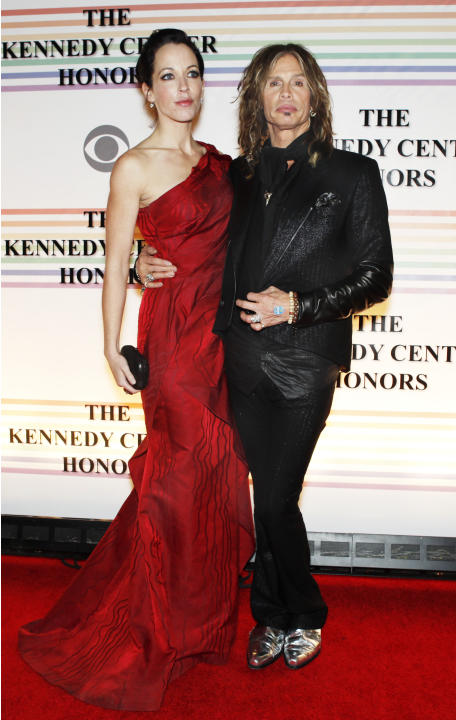 FILE - In this Dec. 10, 2010 file photo, Erin Brady, left, and Steven Tyler of Aerosmith, walk the red carpet at the Kennedy Center Honors in Washington. Tyler's representative confirmed Monday, Jan.