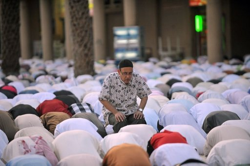Men in Saudi Arabia pray on the first day of Eid al-Fitr in the great mosque in the old city of Riyadh, on August 19, 2012 to mark the end of the holy fasting month of Ramadan. The holiday will begin in Saudi Arabia on Wednesday, the royal cabinet announced in a statement Monday, citing the kingdom's religious authorities