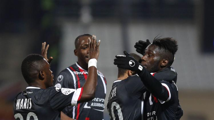Arthur Masuaku of Valenciennes celebrates his goal against Olympique Marseille with teammates during their French Ligue 1 soccer match at the Velodrome Stadium in Marseille