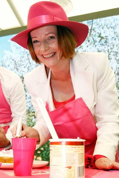 SYDNEY, AUSTRALIA - JANUARY 05:  Australian Prime Minister Julia Gillard makes a cake she made at a Jane McGrath High Tea during day three of the Second Test Match between Australia and India at Sydne