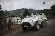 A United Nations armoured personnel carrier drives along the road between Goma and Rutshuru in the Democratic Republic of the Congo's North Kivu province in May 2012. UN and Democratic Republic of Congo troops are reinforcing Goma in the east of the country to guard against attack by rebels who have seized ground in recent days, UN officials said