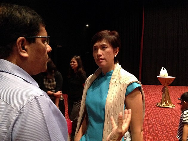 Minister of State for Finance and Transport Josephine Teo speaks to a REACH pre-Budget 2013 forum participant. (Yahoo! photo)