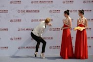 Actress Nicole Kidman in the Eastern port city of Qingdao on September 22, 2013. Kidman, Leonardo DiCaprio and John Travolta on Sunday added their star power to the glitzy inauguration of the Qingdao Oriental Movie Metropolis, billed as China's answer to Hollywood