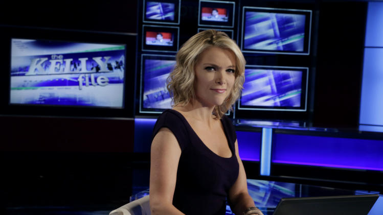 "Megyn Kelly, host of Fox News Channel's ""The Kelly Files,"" poses for a photo as she rehearses for the debut of her new prime-time show, in New York, Friday, Oct. 4, 2013. Her program is the linchpin to the first overhaul of Fox's prime-time lineup since 2002, or about a century in television time. (AP Photo/Richard Drew)"