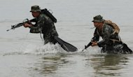 Members of Philippine marines reconaissance team run from the sea during a military exercise in Puerto Princesa, Palawan island, south of Manila on April 23. Philippine government websites are under heavy attack from hackers, apparently from China, amid a tense territorial dispute between the two countries in the South China Sea, officials said Thursday