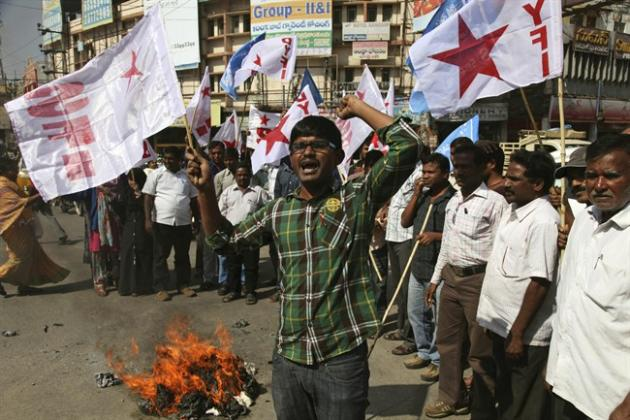 Left party activists shout slogans after burning an effigy of the U.S. to protest against the alleged mistreatment of New York based Indian diplomat Devyani Khobragade, in Hyderabad, India, Wednesday,