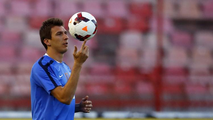 Croatia's Mandzukic plays with a ball during a training session in Belgrade