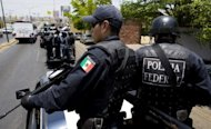File photo shows Mexican Federal Police on patrol in the city of Culiacan during an anti-drug trafficking operation in Sinaloa state. Seven police officers and four gunmen were killed Monday in a shootout in Mexico's northwestern state of Sinaloa, a stronghold of one of the country's ruthless drug gangs, officials said