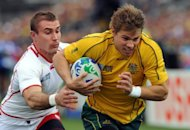 Australia's Wallabies wing Drew Mitchell (right) runs to score a try in front of Russia's Vladimir Ostroushko during a 2011 Rugby World Cup match at Trafalgar Park in Nelson. Mitchell and Radike Samo were recalled for the inaugural Rugby Championship and there were three uncapped players in a Wallabies squad that coach Robbie Deans said provided depth