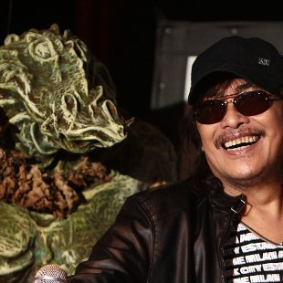 "A replica of ""Bangis"" with creator Carlo J. Caparas (Jerome Ascano, NPPA Images)"