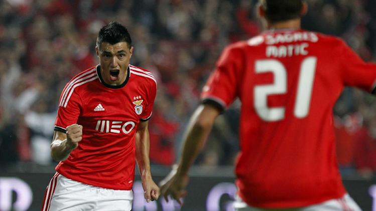 Benfica's Oscar Cardozo, left, celebrates with teammate Nemanja Matic from Serbia after scoring the opening goal against Sporting during a Portugal Cup soccer match between Benfica and Sporting at Benfica's Luz stadium in Lisbon, Saturday, Nov. 9, 2013