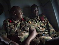 Ugandan army spokesman Felix Kulayigye (L) smiles next to Ceasar Acellam, a senior member of the Lord's Resistance Army. Ugandan troops have captured a senior member of the LRA in a milestone arrest that could signal they are closing in on notorious rebel leader Joseph Kony