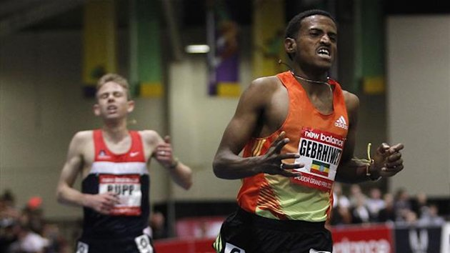 Hagos Gebrhiwet of Ethiopia (R) crosses the finish line in front of Galen Rupp (L) of the U.S. to win the men's 3000 meters during the New Balance Indoor Grand Prix track meet in Boston, Massachusetts