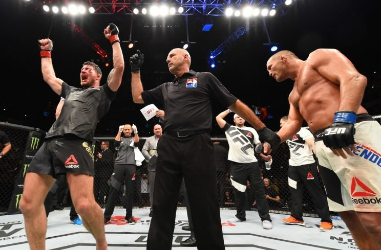 Michael Bisping was dropped early in his rematch with Dan Henderson but found a way to survive. (Getty)