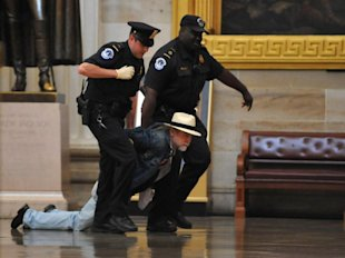 Dragging Out Through Tough Times—Business Email Service image Protesters Dragged Out of Capitol