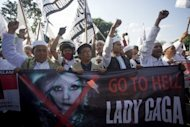 "Indonesian Islamic hardliners chant ""Go to hell, Lady Gaga"" during a protest outside the US embassy on May 25 against the singer's scheduled Jakarta concert. Pop diva Gaga on Sunday cancelled her Indonesian concert with promoters saying the security threat was too serious after Islamic hardliners promised ""chaos"" if she entered the Muslim nation"