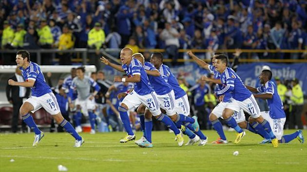 "Millonarios players celebrate after defeating Independiente Medellin by penalty kicks in the final match of the Colombian First Division soccer league ""Liga Postobon"" in Bogota (Reuters)"