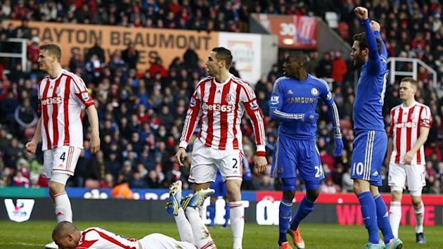 Chelsea's Juan Mata (R) celebrates an own goal from Stoke City's Jonathan Walters (2nd L) during their English Premier League soccer match at the Britannia Stadium in Stoke-on-Trent, northern England, January 12, 2013 (Reuters)