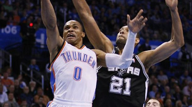 Oklahoma City Thunder guard Russell Westbrook (L) shoots against San Antonio Spurs forward Tim Duncan (C) and Nando De Colo of France (R) (Reuters)