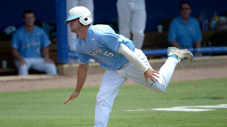 North carolina s alex raburn stumbles on his way to home plate but