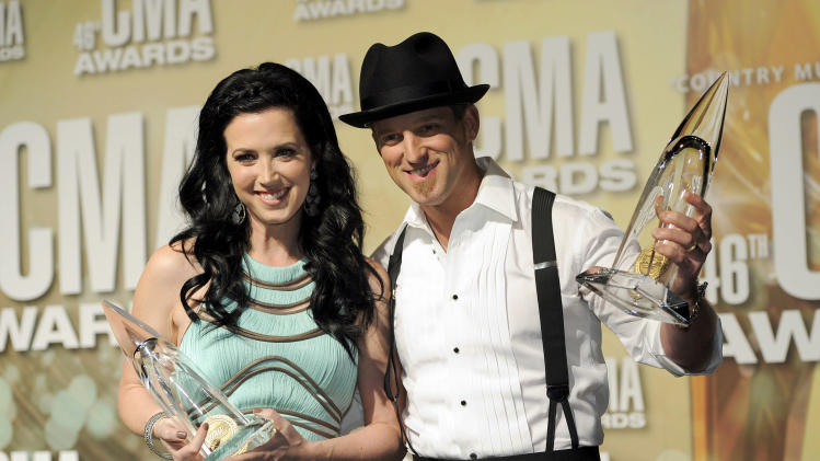 Shawna Thompson, left, and Keifer Thompson, Thompson Square, pose backstage with the award for vocal duo of the year at the 46th Annual Country Music Awards at the Bridgestone Arena on Thursday, Nov. 1, 2012, in Nashville, Tenn. (Photo by Chris Pizzello/Invision/AP)
