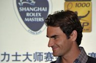 Roger Federer admitted on Sunday that a bizarre online death threat had been a distraction in the build-up to the Shanghai Masters but said he was now focusing on action on the court