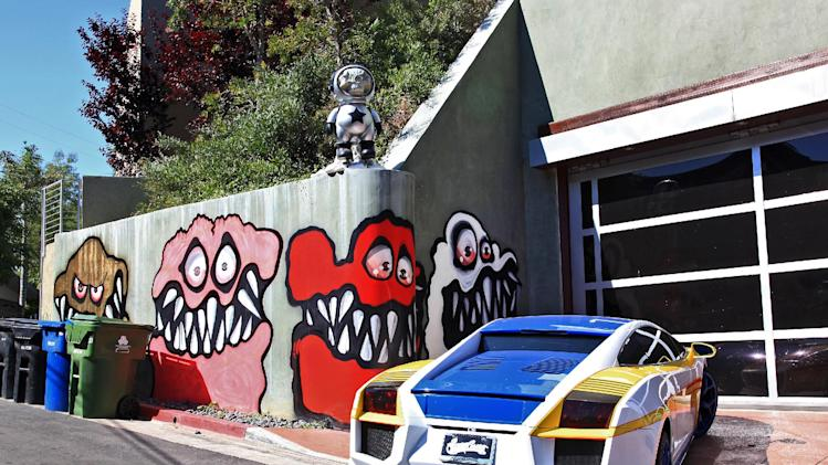 This Sunday May 12,2013 photo shows a mural painted on the outside of musician Chris Brown's home in Los Angeles. The Grammy-winning musician's neighbors are unhappy with what some are calling frightening art he's chosen to have painted along the curb of his Hollywood Hills home. (AP Photo/Richard Vogel)
