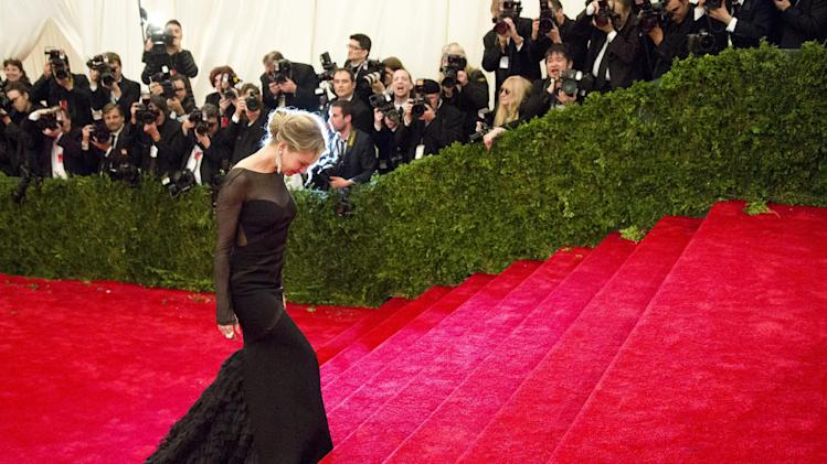 Renee Zellweger arrives at the Metropolitan Museum of Art Costume Institute gala benefit, celebrating Elsa Schiaparelli and Miuccia Prada, Monday, May 7, 2012 in New York. (AP Photo/Charles Sykes)