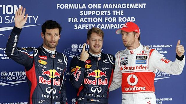 Red Bull Formula One driver Mark Webber (L) of Australia, team mate Sebastian Vettel (C) of Germany and McLaren Formula One driver Jenson Button of Britain wave after the qualifying session of the Japanese F1 Grand Prix at the Suzuka circuit (Reuters)