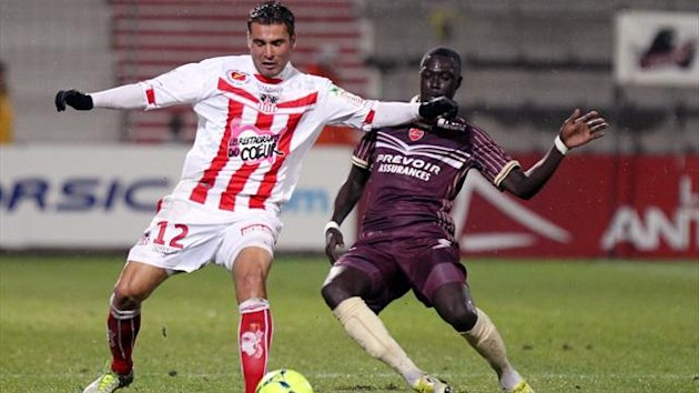 Ajaccio striker Adrian Mutu in action against Valenciennes