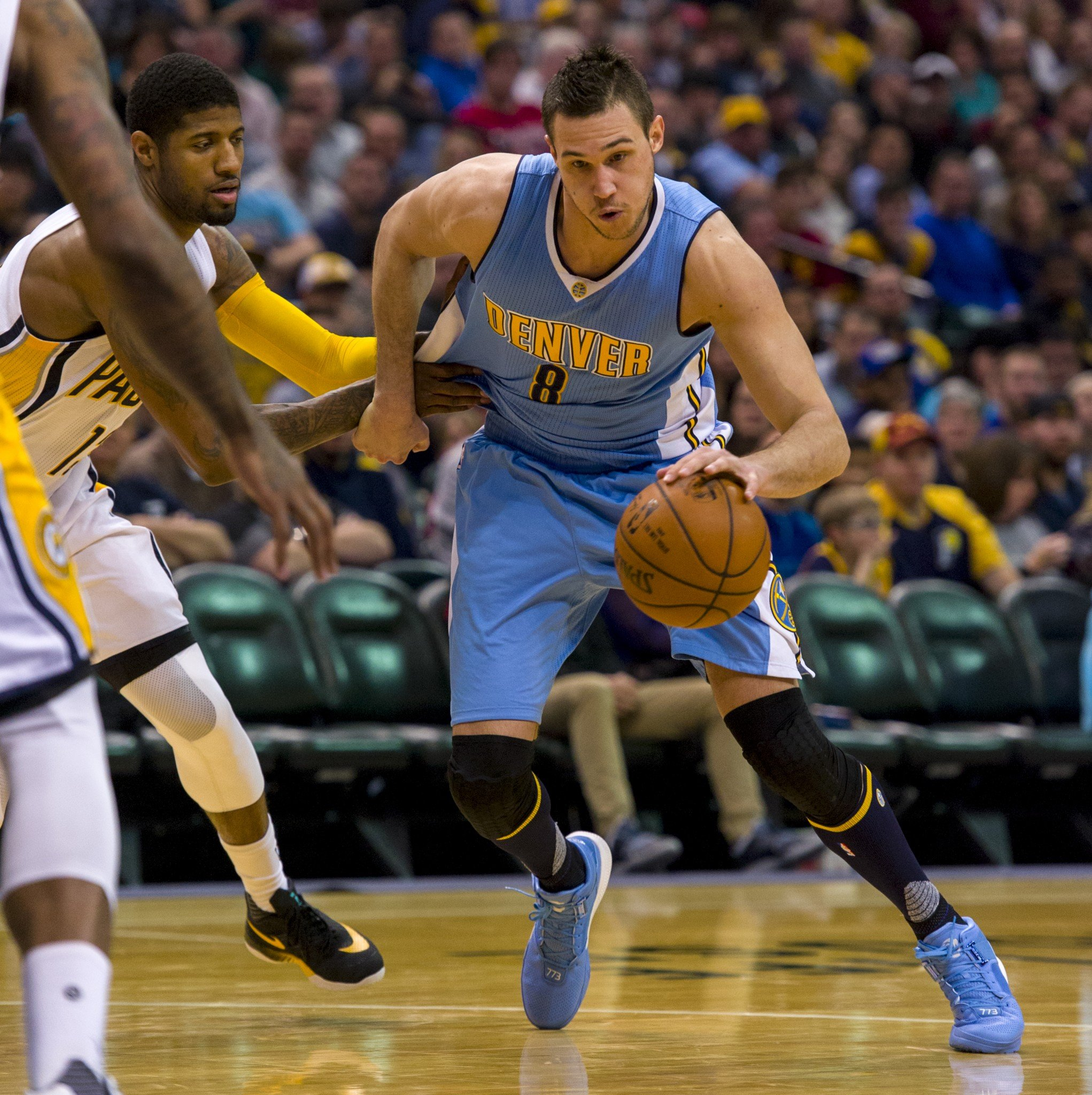 Denver Nuggets forward Danilo Gallinari tries to dribble past the defense of Indiana Pacers forward Paul George during a Jan. 30, 2016, game. (AP/Doug McSchooler)
