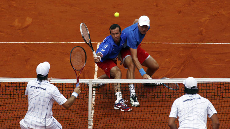 Stepanek of Czech Republic plays a shot next to Berdych during their Davis Cup World Group doubles match against Schwank and Berlocq in Buenos Aires