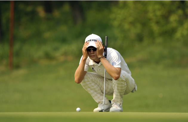 This handout photo provided by AsiaOne shows Kim Bi-o of South Korea during the 31st GS Caltex Maekyung Open Golf Championship at the Nam Seoul Golf and Country Club in Seoul on May 10, 2012.  The 900