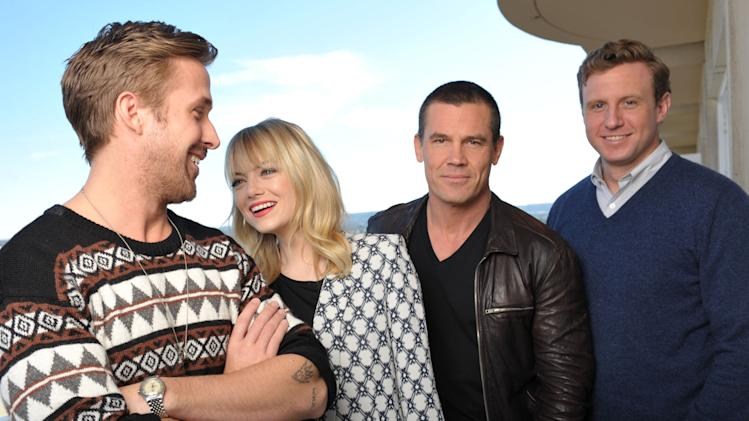 "FILE - In thsi Dec. 15, 2012 file photo, from left,  actor Ryan Gosling, actress Emma Stone, actor Josh Brolin and director Ruben Fleischer from the film ""Gangster Squad,"" pose for a portrait at the Four Seasons Hotel, in Beverly Hills, Calif. (Photo by John Shearer/Invision/AP, File)"