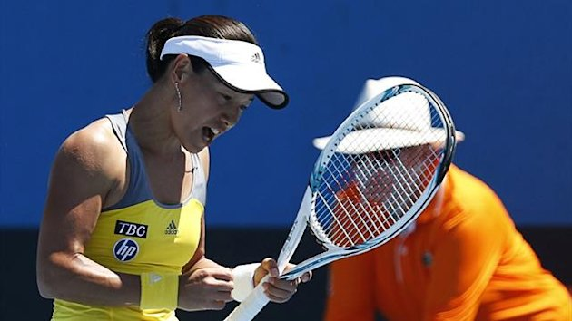 Kimiko Date-Krumm of Japan celebrates beating Nadia Petrova of Russia at the Australian Open in Melbourne (Reuters)