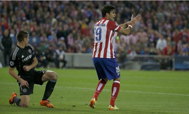 Atletico Madrid's Diego Costa requests a handball decision by the referee after Chelsea?s Cesar Azpilicueta played the ball during their Champions League semi-final first leg soccer match at Vicen