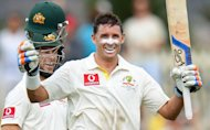 Australia veteran Mike Hussey celebrates his century against Sri Lanka on during the first Test match in Hobart, Tasmania, on December 15, 2012. Hussey has announced he will retire from Test cricket after next week's third and final clash against Sri Lanka in Sydney