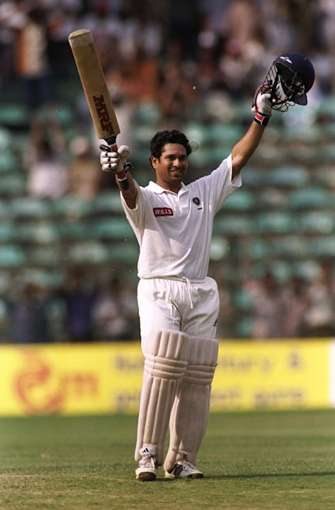 Sachin Tendulkar of India celebrates reaching the century mark